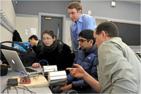 Build a Small Radar System – Students and instructors working on a radar.
